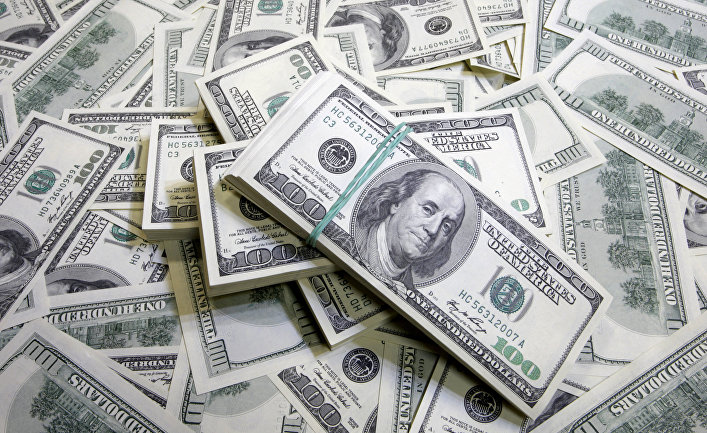 Тенге упал в обменниках до 381 за доллар
